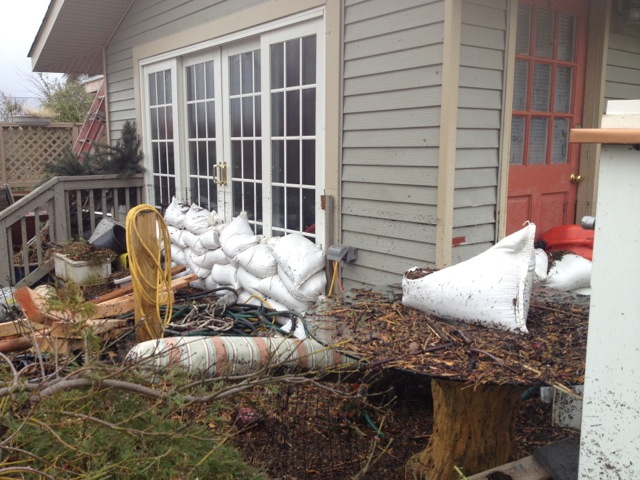 This is the back of Joe's home the morning after the storm. Everything was under water and things were in his yard that he has no idea where they came from.