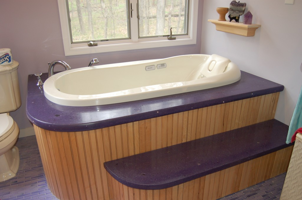 This concrete tub surround design features fiber optics and chunks of embedded amethyst.