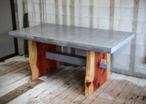Wood and concrete combine to create this hardworking table available in Duncan's Tacoma showroom.