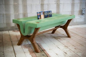 This gorgeous green concrete table doubles as a magazine rack
