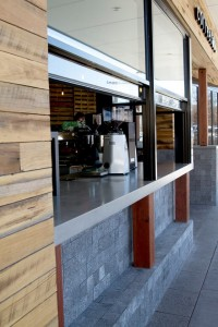 The architects at this cafe love the look of concrete making Mitchell's work a prominent part of the overall design.