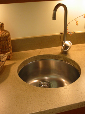 small round sink in concrete countertop