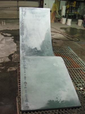 concrete lounge chair blue grout