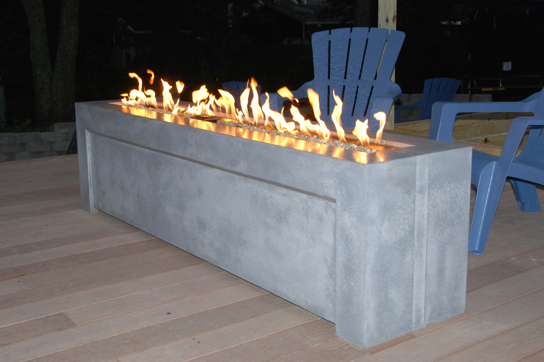 This modern inspired concrete fire pit is the perfect place to warm up on a chilly New Jersey night.
